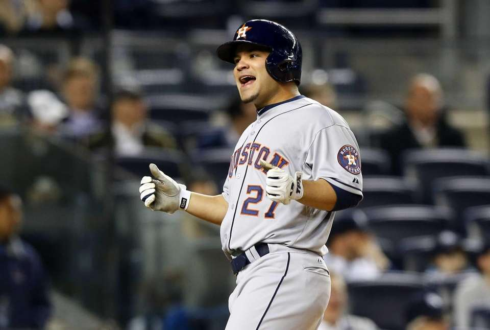 Jose Altuve celebrates after scoring in the fourth