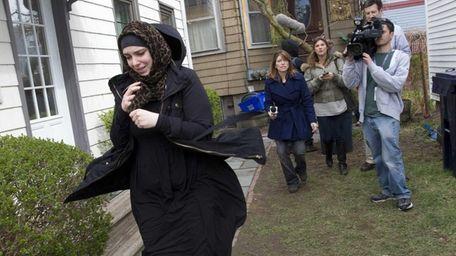 Katherine Russell Tsarnaev, wife of Tamerlan Tsarnaev, leaving