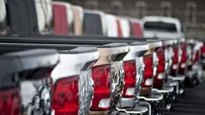 2012 Dodge Ram pickup trucks sit on display