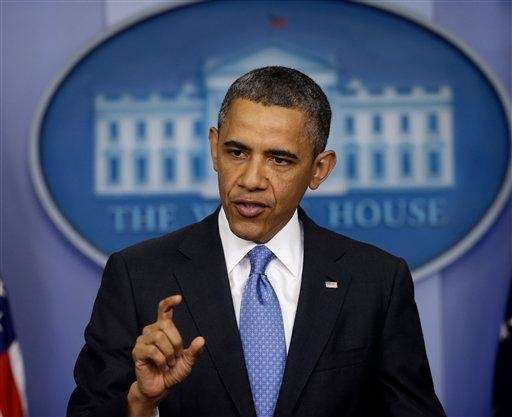President Barack Obama answers questions during his new