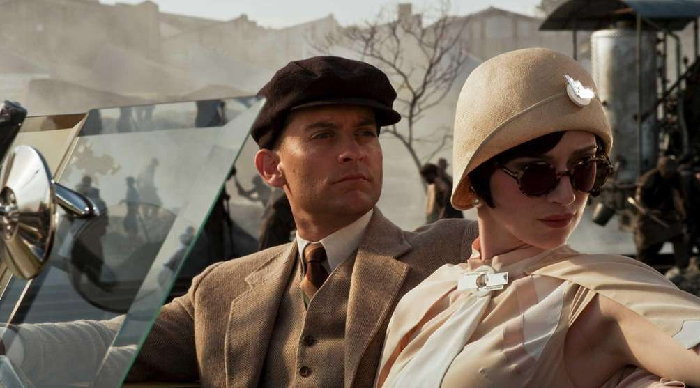 Pictured from left: Tobey Maguire as Nick Carraway