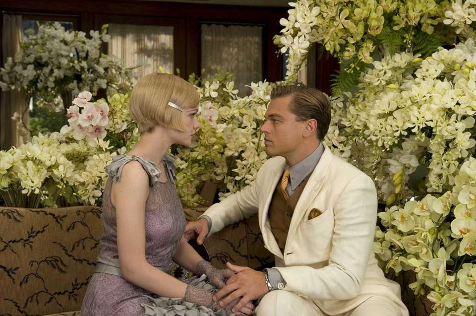 Leonardo DiCaprio as Jay Gatsby and Carey Mulligan