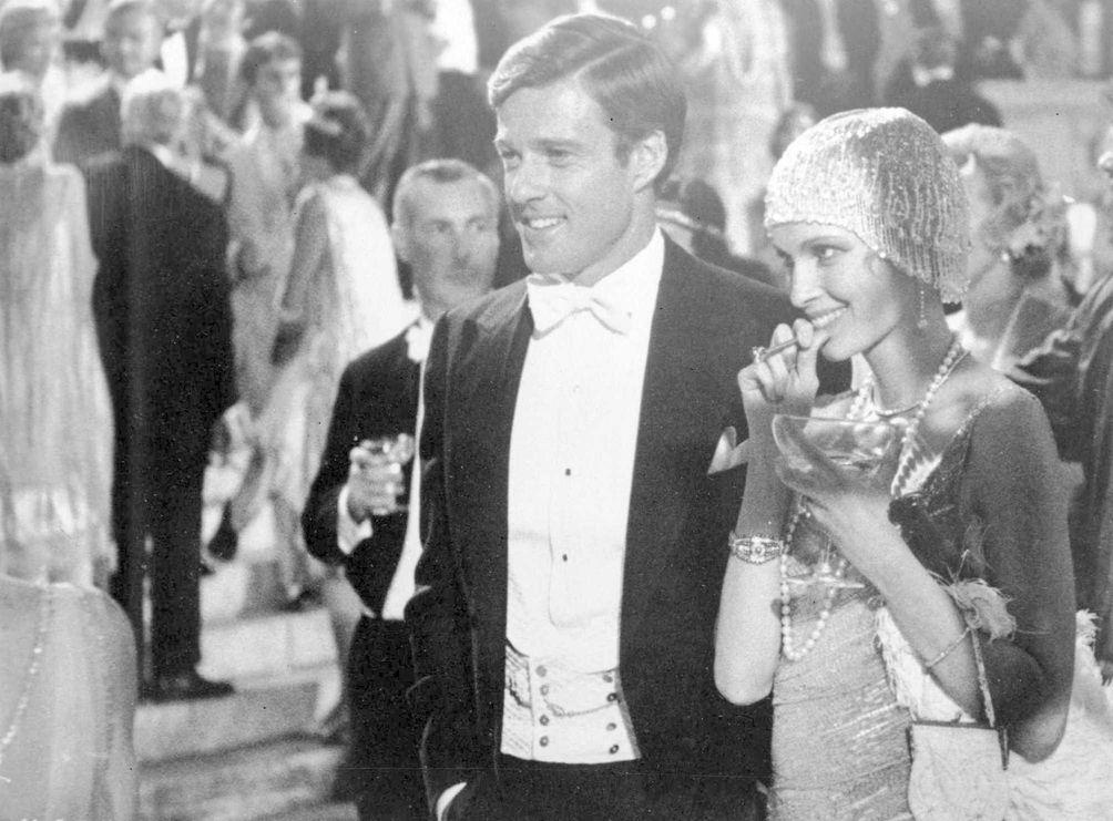 Robert Redford as Jay Gatsby and Mia Farrow