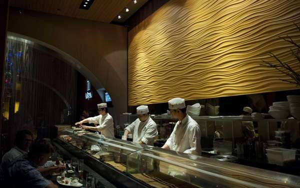 Chefs at the Nisen sushi bar prepare a