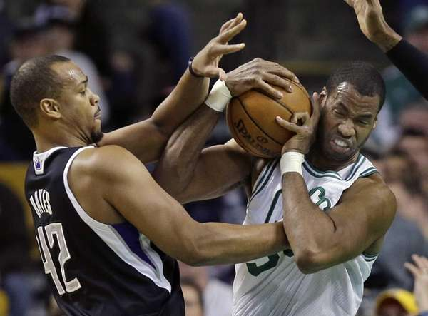 Then-Boston Celtics center Jason Collins, right, struggles for