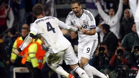 Sergio Ramos celebrates with Karim Benzema after scoring,