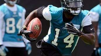 Jacksonville Jaguars wide receiver Justin Blackmon (14) runs