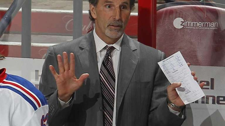 John Tortorella directs his players during third-period action