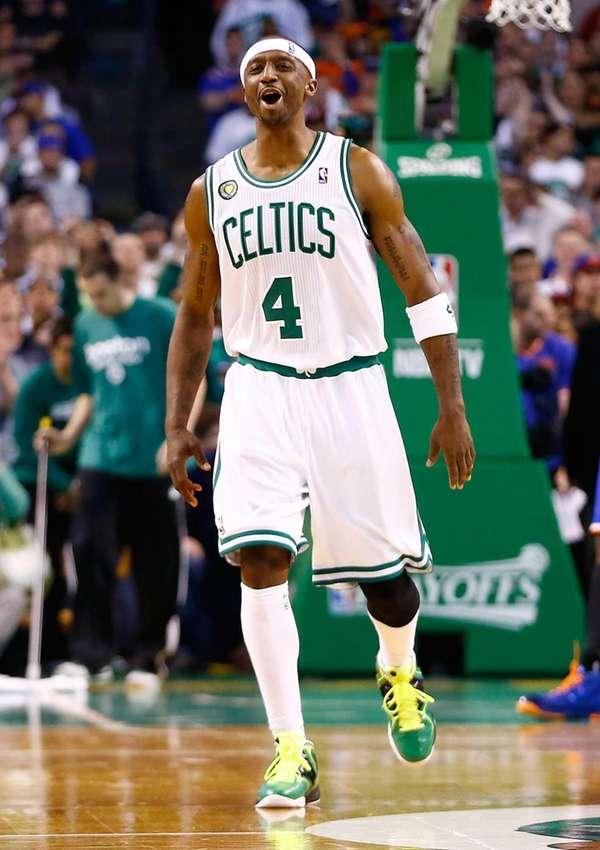 The Boston Celtics' Jason Terry celebrates after making