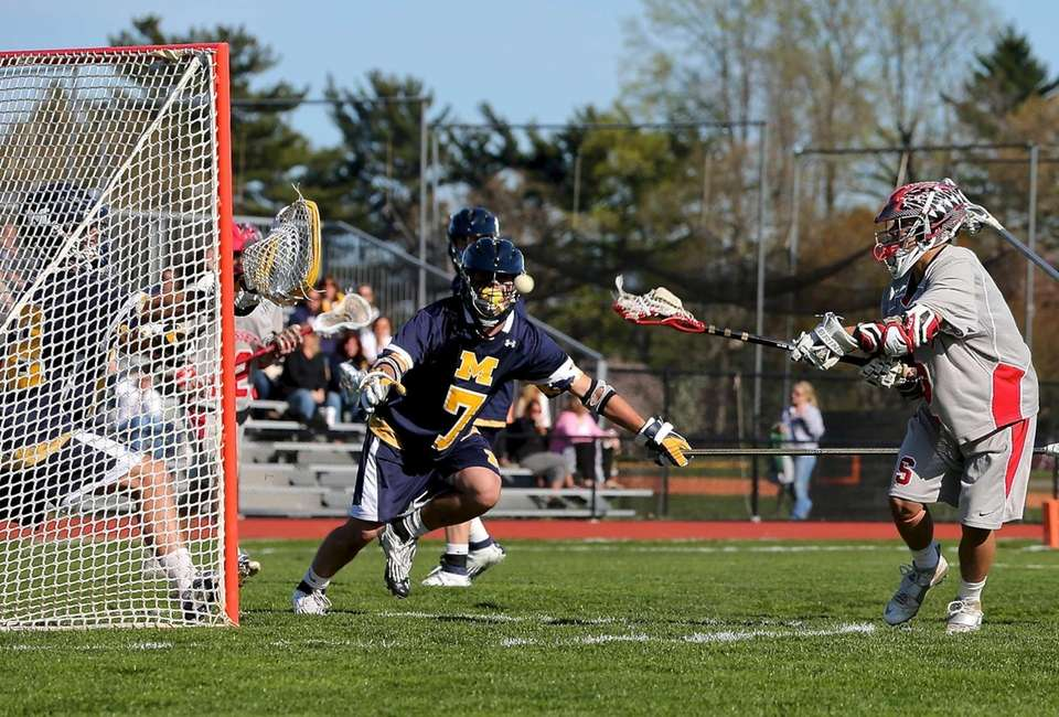 Syosset's Alex Concannon scores during a game against
