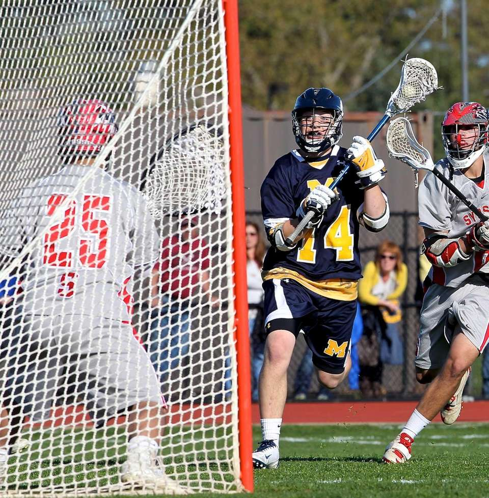 Massapequa's Paul Bentz comes in on Syosset goalie
