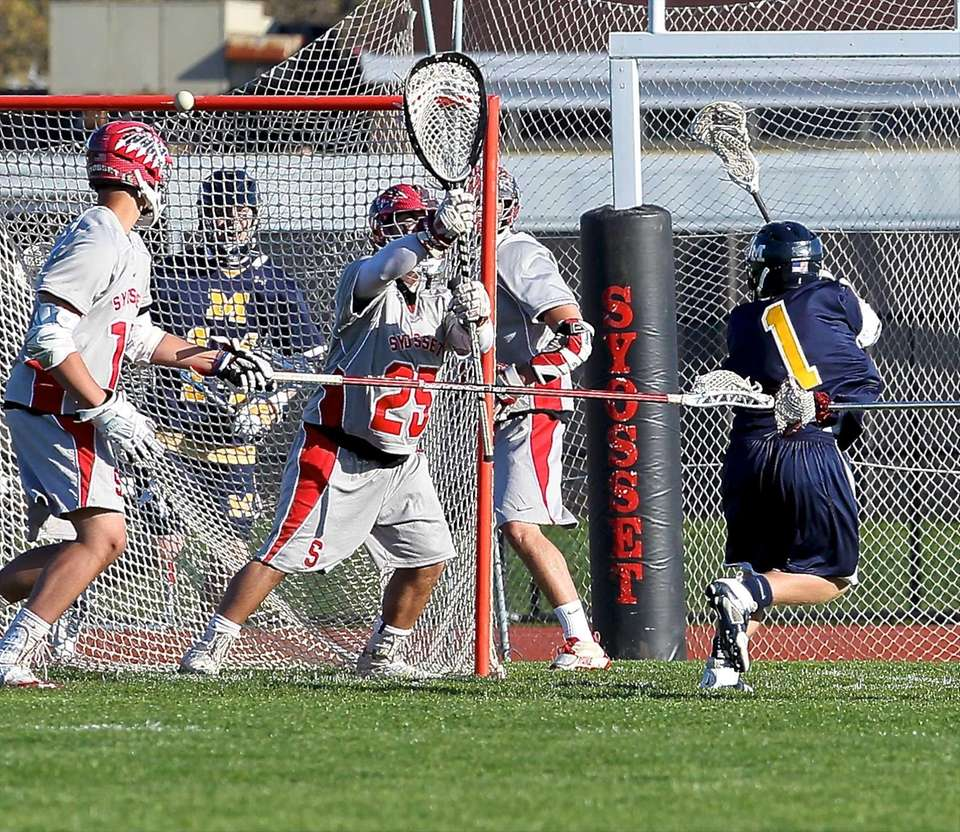 Massapequa's Jim Byrns puts the shot over Syosset