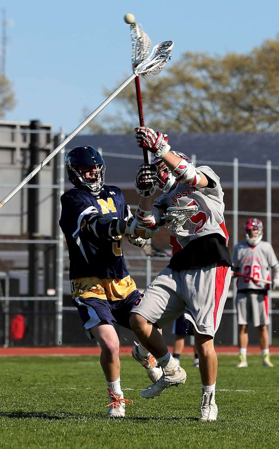 Syosset's Alex Hatzopoulos scores during a game against
