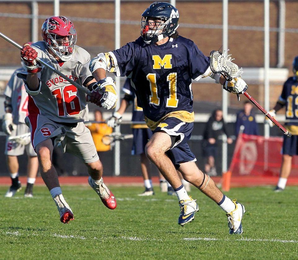 Massapequa's Craig Berge moves toward the goal past