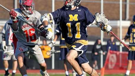 Massapequa's Craig Berge moves toward the goal past