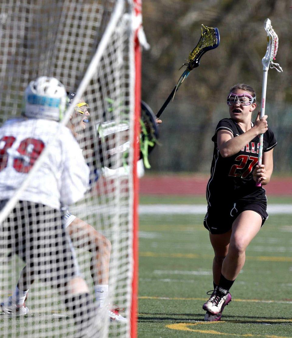 Hills' Jennifer Casadonte drives in on goalie Lauren