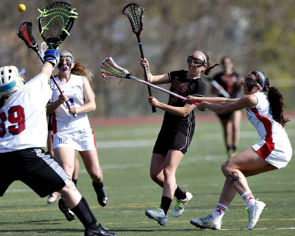Hills' Cara Pascarella shoots and scores against goalie
