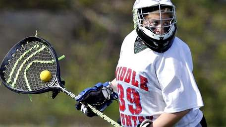 Middle Country goalie Lauren Young looks for the