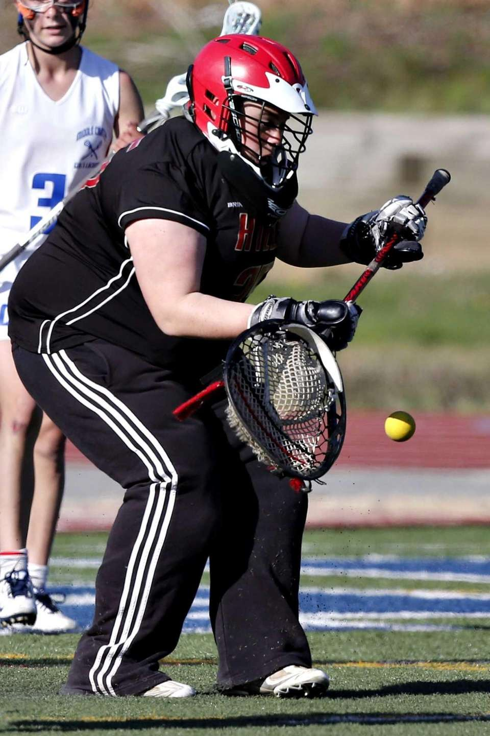 Half Hollow Hills goalie Jillian Rocco stops a