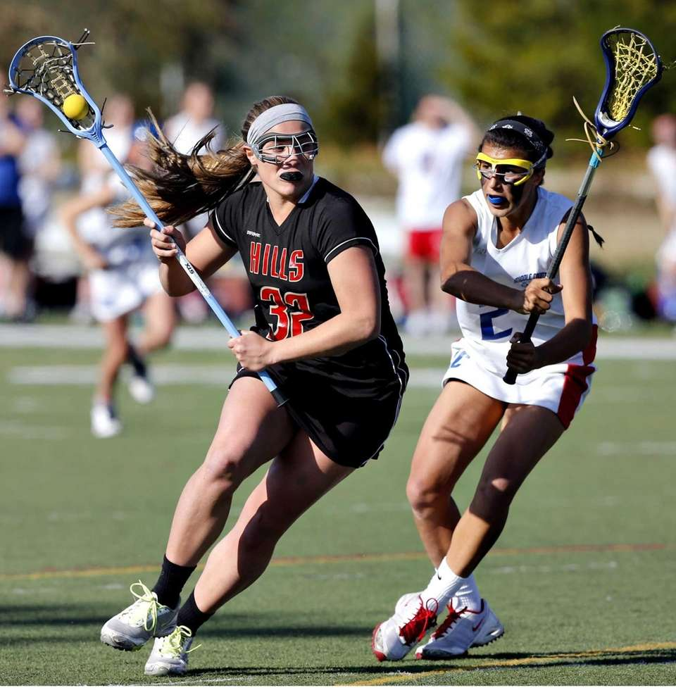 Hills' Alexis Maffucci drives around Middle County defender