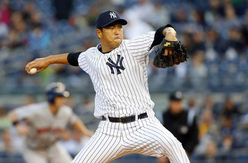 Hiroki Kuroda delivers a pitch in the first