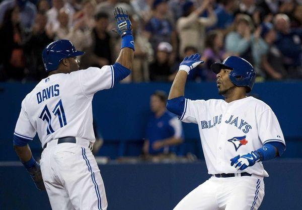 Toronto Blue Jays' Edwin Encarnacion, right, celebrates his