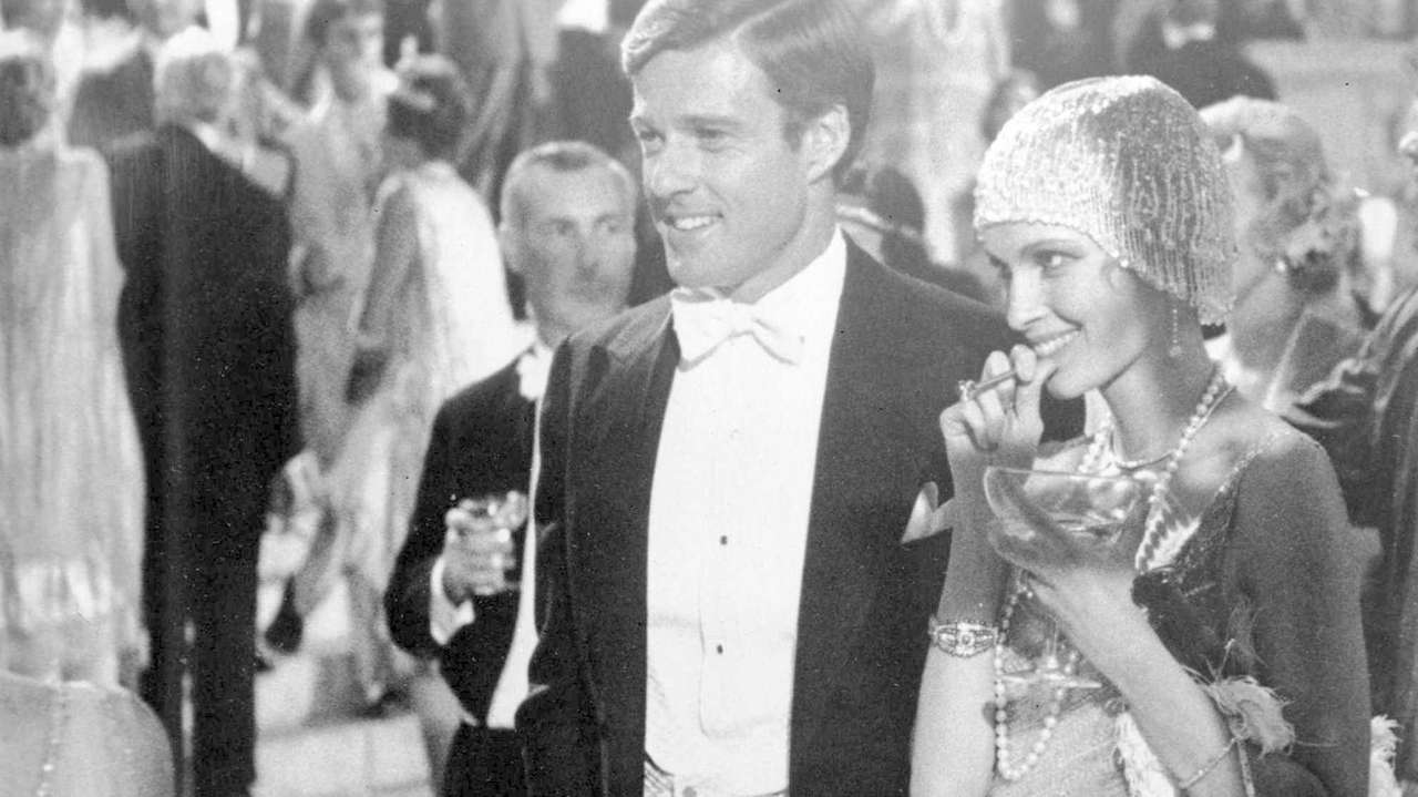 Robert Redford as Jay Gatsby and Mia Farrow