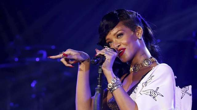 Singer Rihanna performs on her 777 tour at