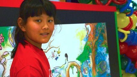 Audrey Zhang, 10, a fourth grader at Michael