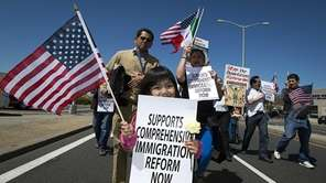 Maria Hernandez, 4, holds a sign during a