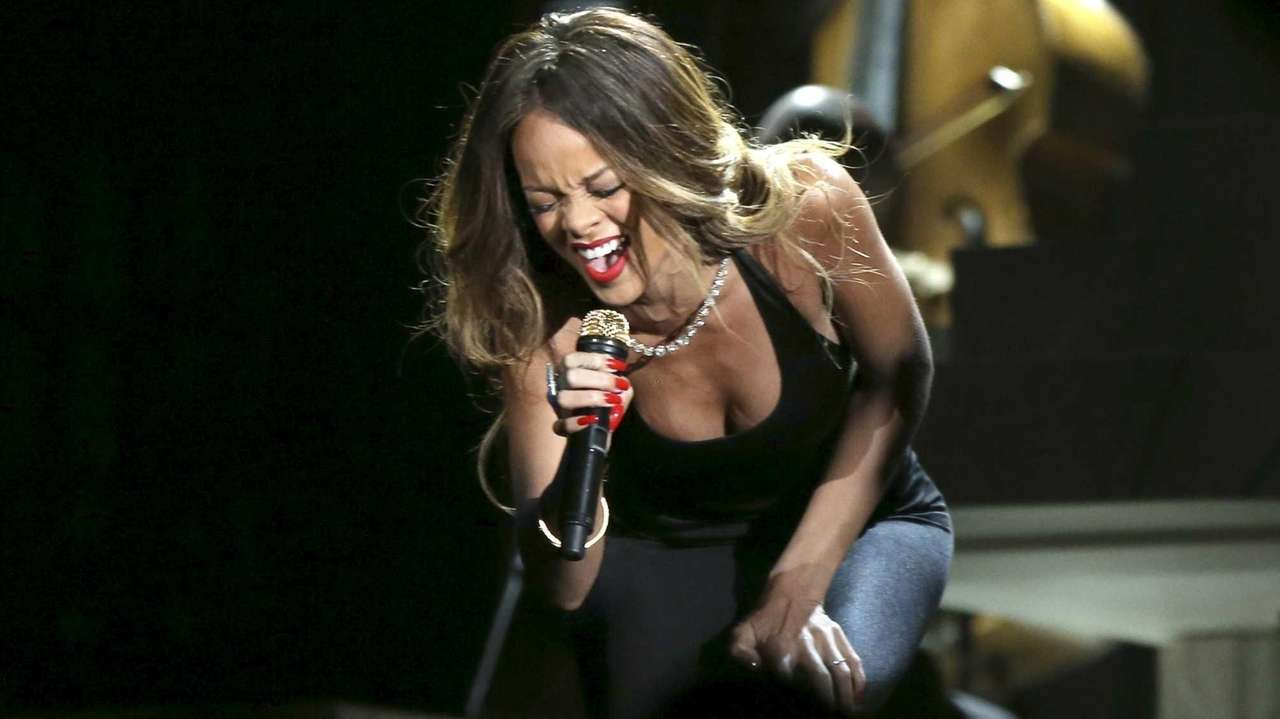 Rihanna performs onstage during the 55th Grammy Awards