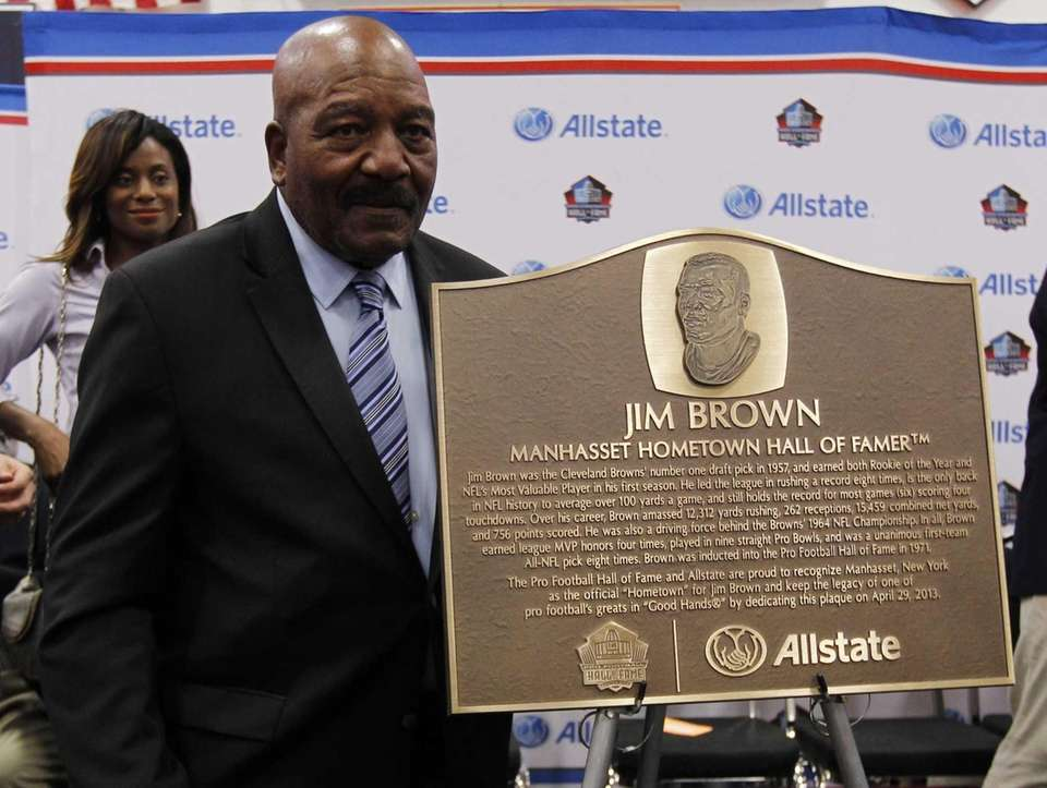 NFL legend Jim Brown poses after being honored