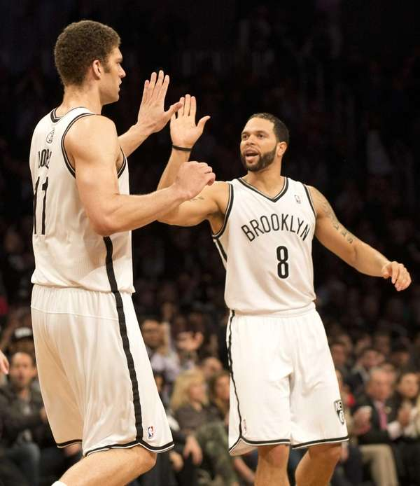 Deron Williams (8) and Brook Lopez (11) celebrate