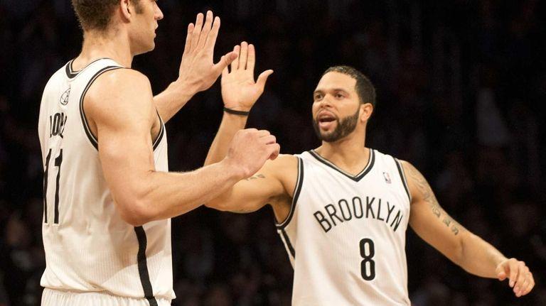 Deron Williams (8) and Brook Lopez (11) celebrate