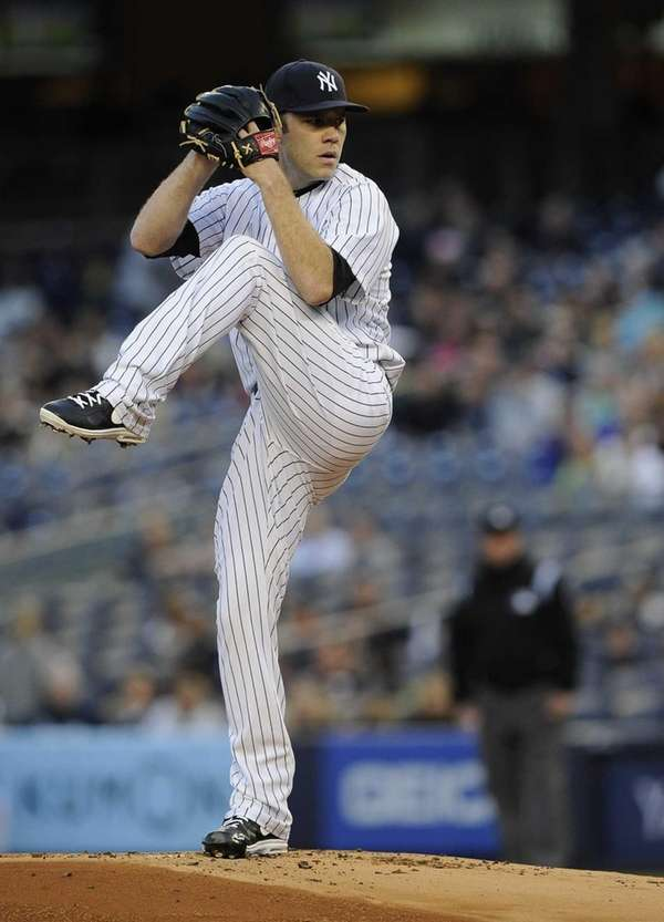 Yankees starting pitcher David Phelps delivers in the