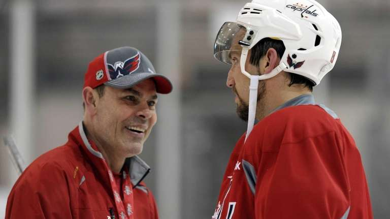 The Washington Capitals' Alex Ovechkin, right, talks with