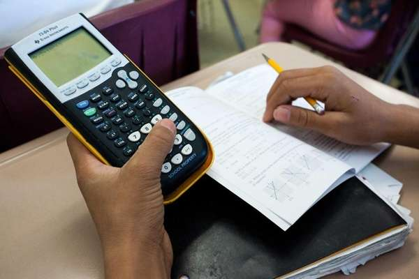 A student uses their calculator to figure out