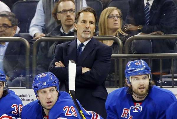 John Tortorella looks on from the bench in