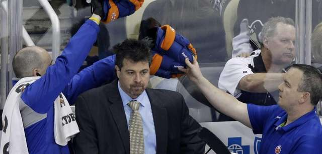 New York Islanders coach Jack Capuano, center, stands