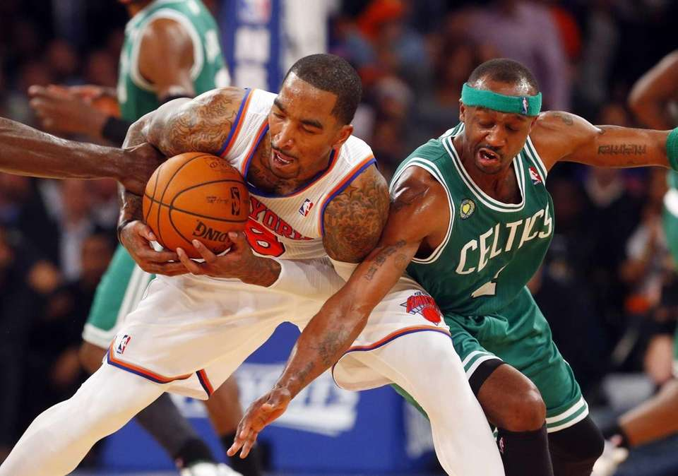 J.R. Smith of the Knicks battles for the
