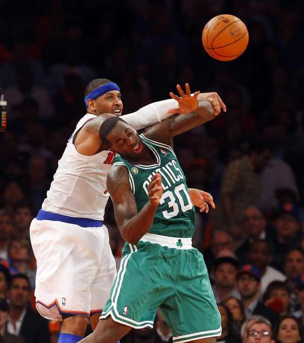 Carmelo Anthony of the Knicks battles for the