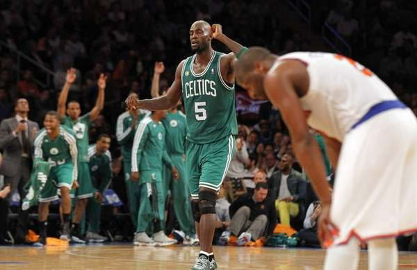 Kevin Garnett and the Boston Celtics bench celebrate