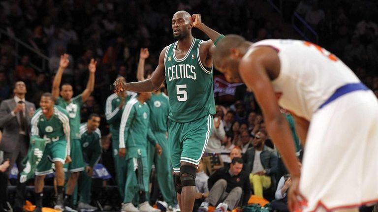 Kevin Garnett and the Boston Celtics bench celebrate