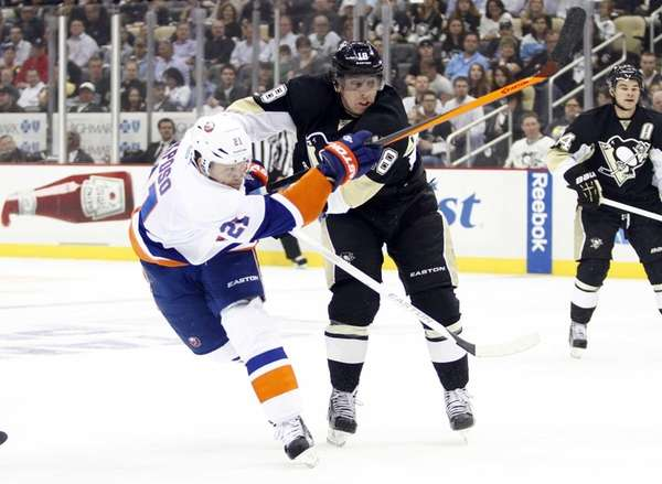 James Neal of the Pittsburgh Penguins checks Kyle