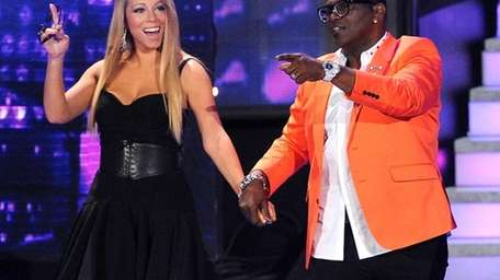 Judges Mariah Carey and Randy Jackson on