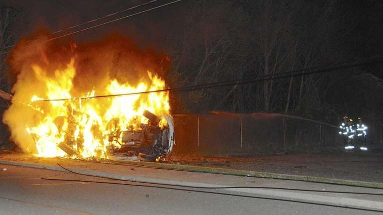 A Mercedes-Benz sedan burst into flames and ended