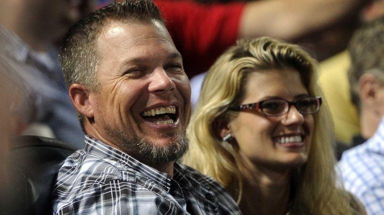 Former Atlanta Braves player Chipper Jones, left, watches