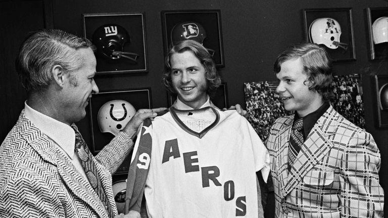 Gordie Howe, left, the former NHL great, checks