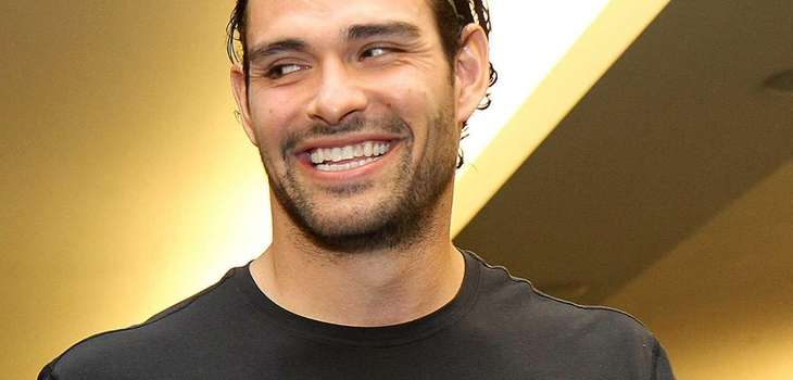 Mark Sanchez talks to reporters during the Jets