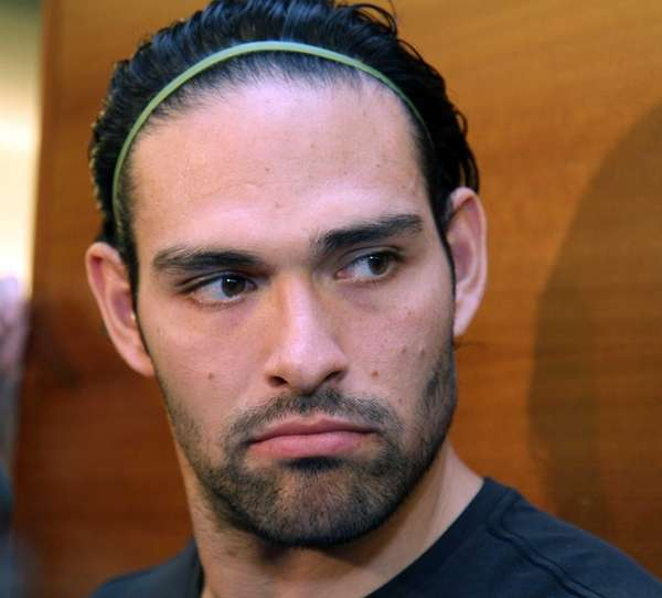 Mark Sanchez talks to the media during the